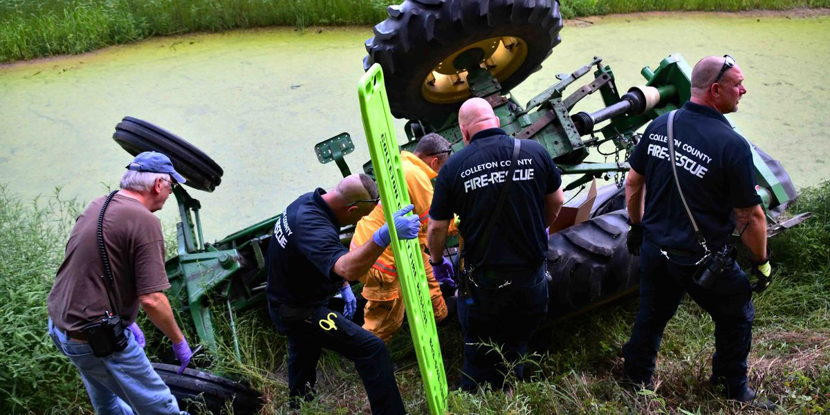Firefighters: 94-year-old man trapped under overturned tractor