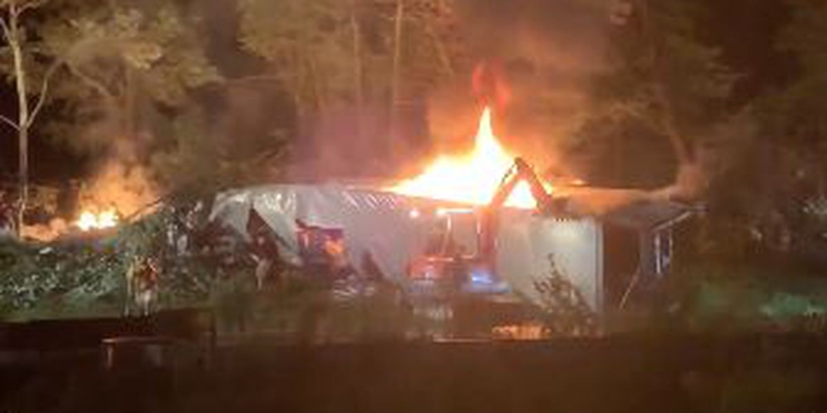 Tractor-trailer overturns, catches fire along I-40 in Iredell County