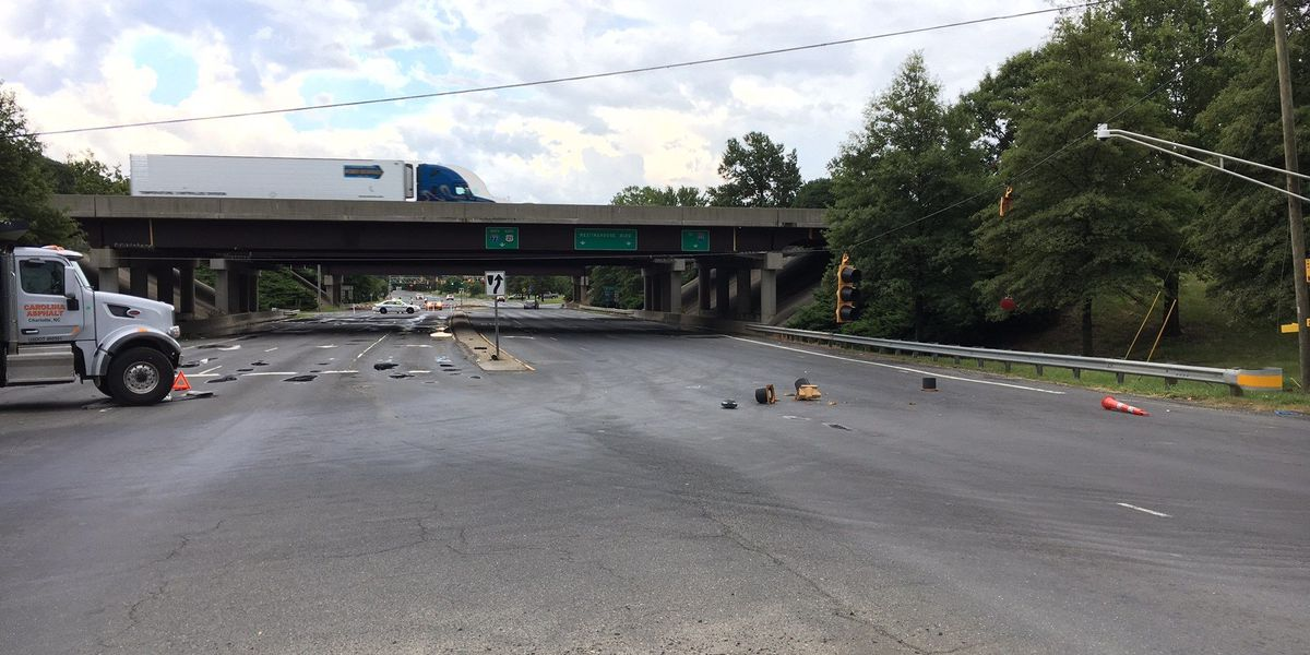 Dump truck driver takes down traffic lights, causes road closure