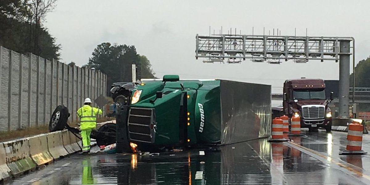 Overturned truck shuts down I-77 in Huntersville Saturday morning