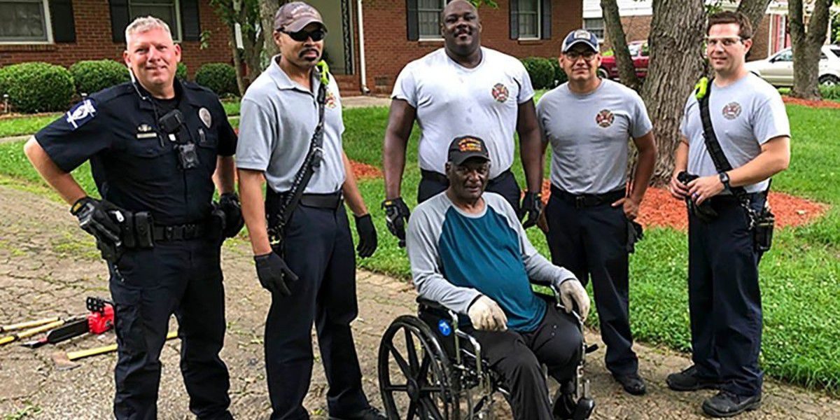 Charlotte police, firefighters help cut up tree that fell in yard of elderly resident