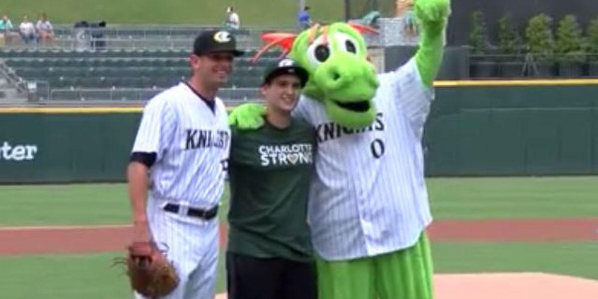 UNCC survivor throws out first pitch at Charlotte Knights game
