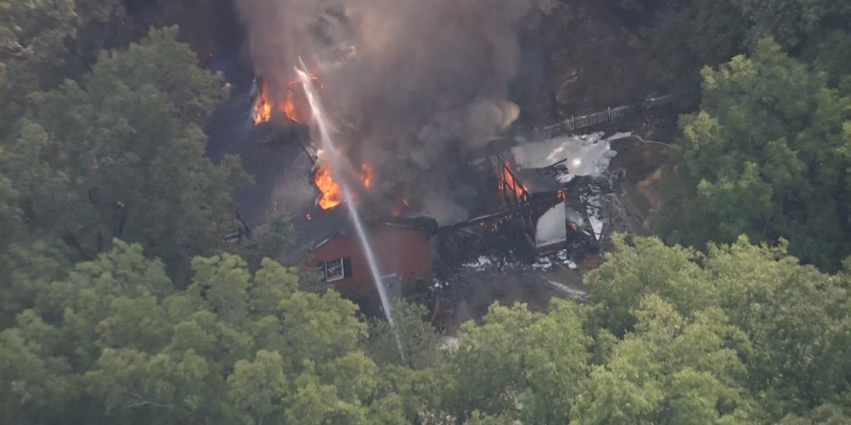 Several firefighters, officers respond to large house fire in Lancaster