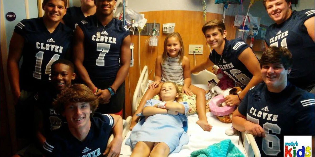 Sept Day 8: High school football team supports 10-year-old girl fighting cancer