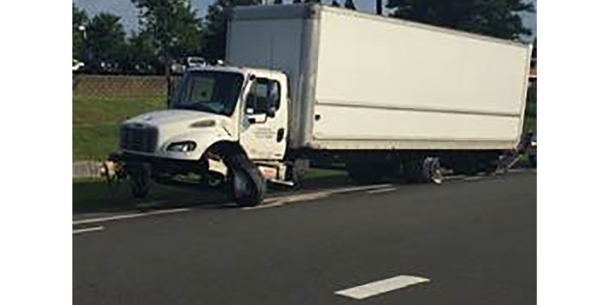 Truck driver crashes into barrier on interstate