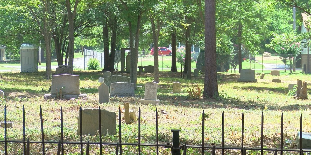 Community uncovers African-American cemetery overgrown with brush