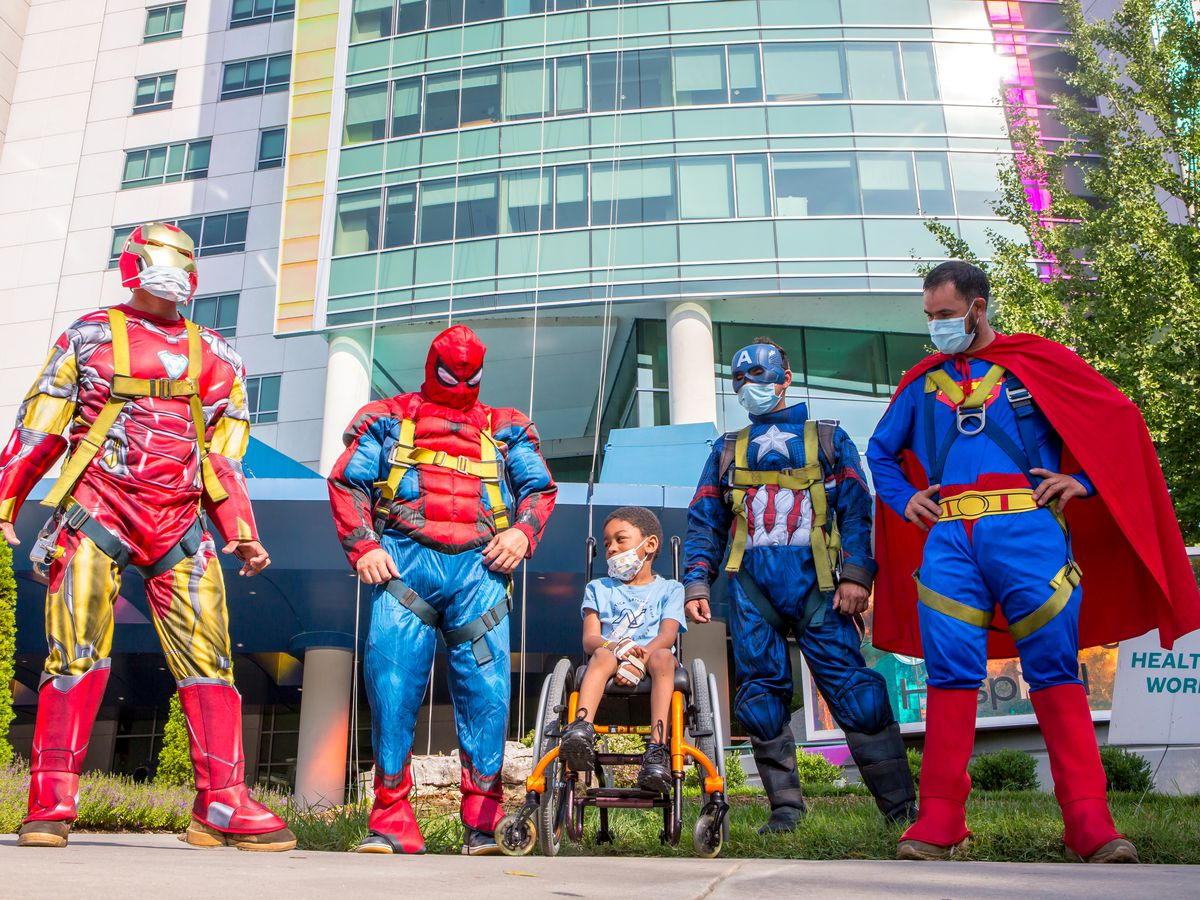 Superheroes make surprise visit to Levine Children's Hospital