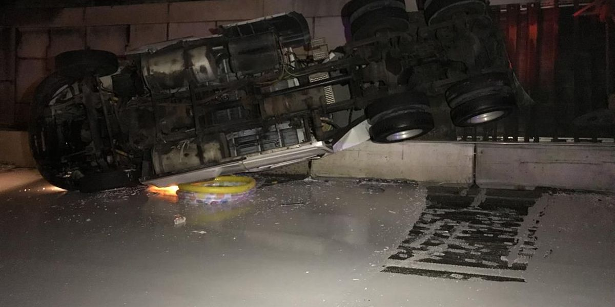 Ramp reopened after tractor trailer overturns, spills gallons of paint on I-85