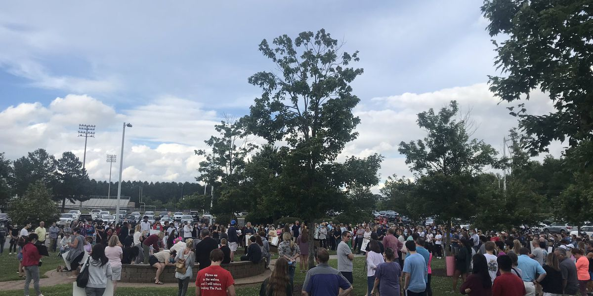 Dozens gather to show support for suspended Ardrey Kell principal