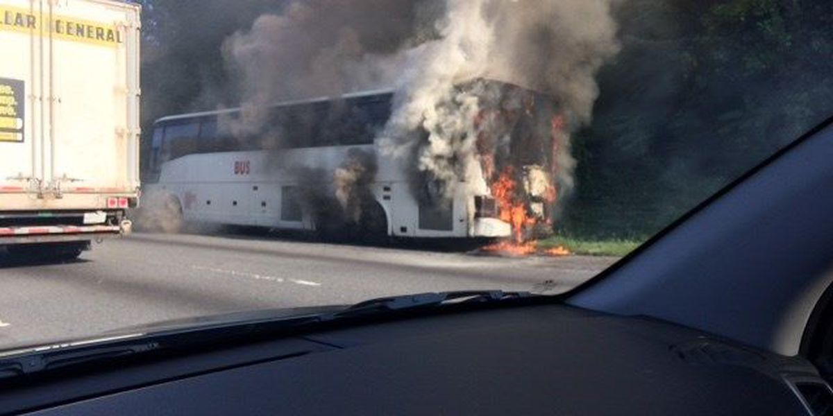 Charter bus catches fire on side of I-85