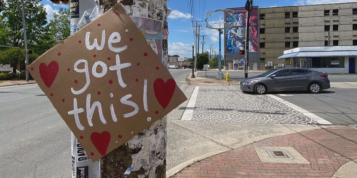Charlotte neighbors giving others a 'sign' that everything will be OK