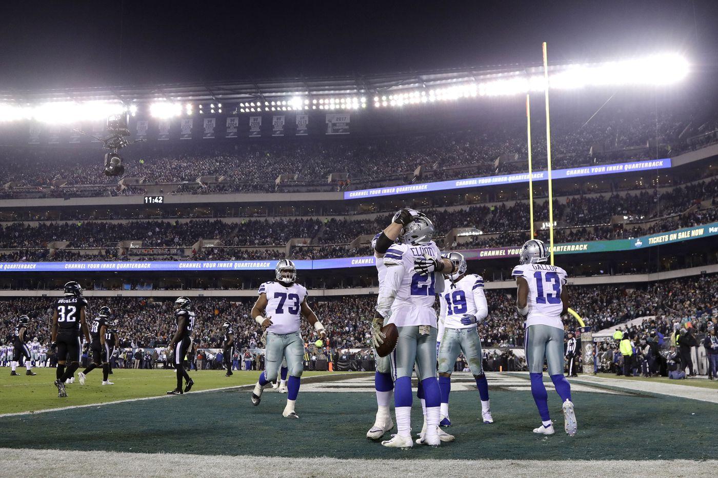 7b57a7079 Dallas Cowboys running back Ezekiel Elliott (21) is congratulated by  teammates after catching a