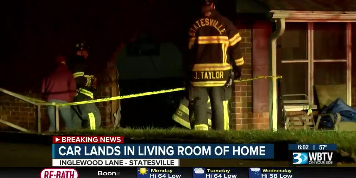 Car barrels into occupied Statesville home
