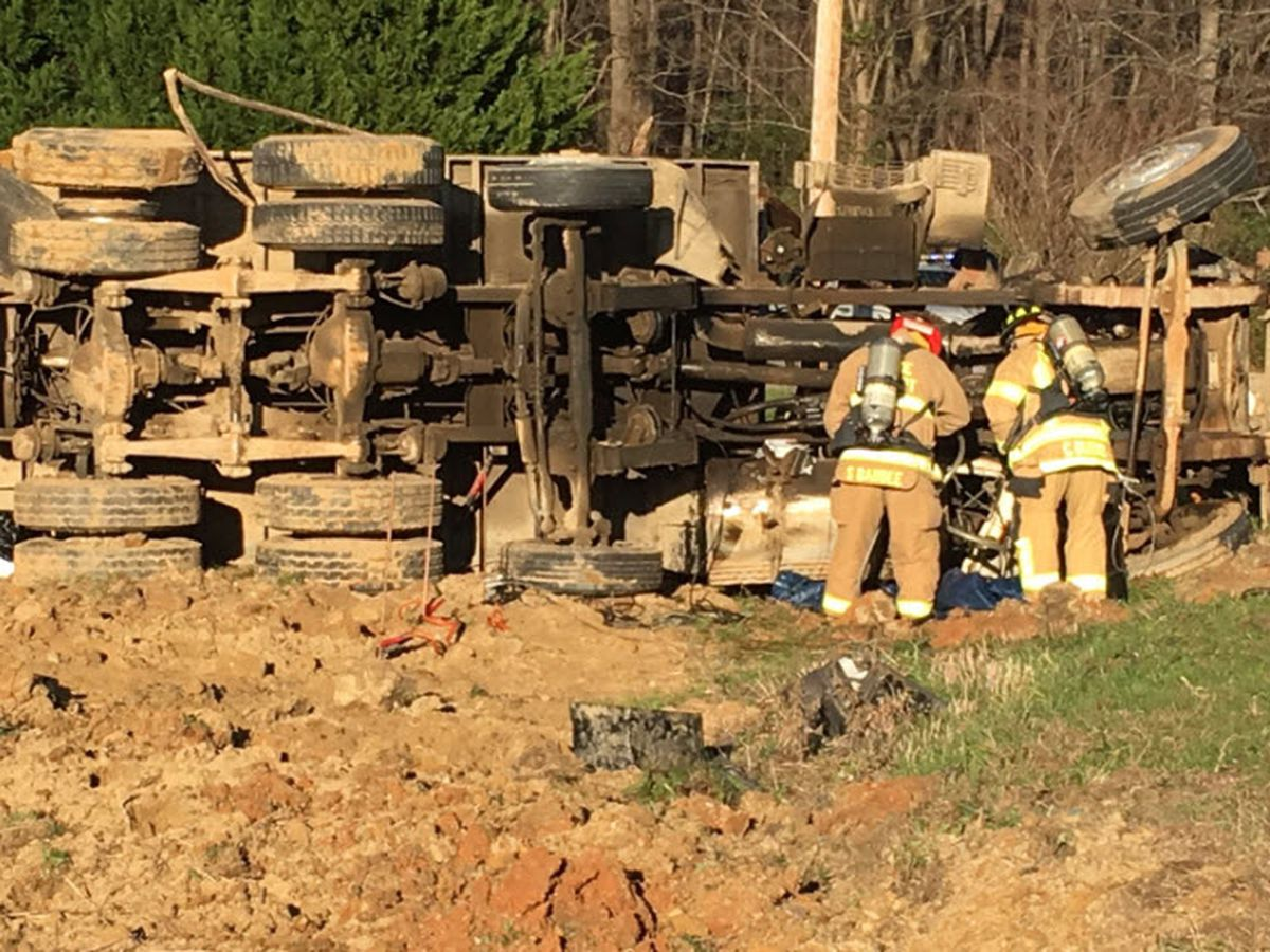 Driver injured when dump truck overturns in Indian Trail