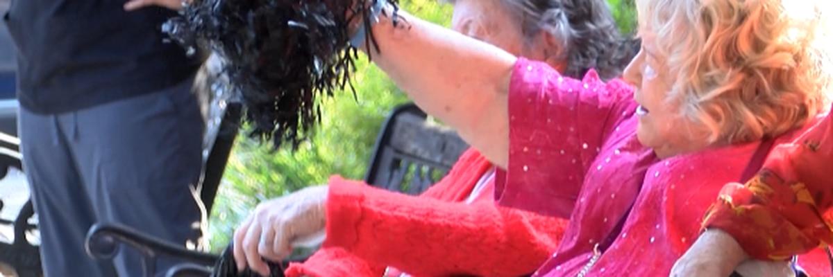 High school pep rally cheers storm displaced nursing home residents