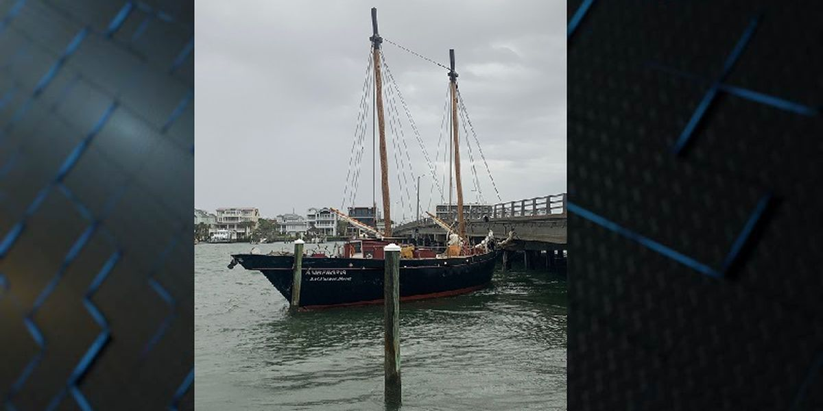Boat breaks free of anchor during storm and gets stuck under bridge in Wrightsville Beach