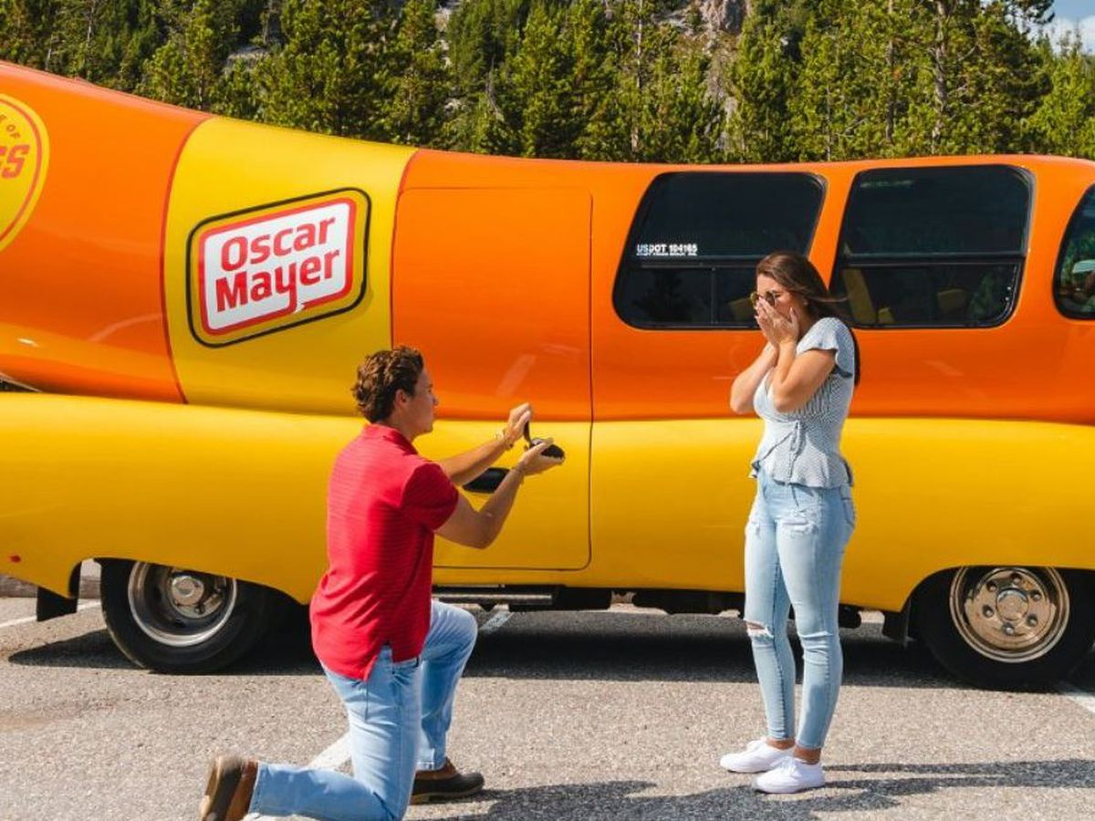 Charlotte-area man pops the question beside his work vehicle. Nation says, 'Hot dog!'