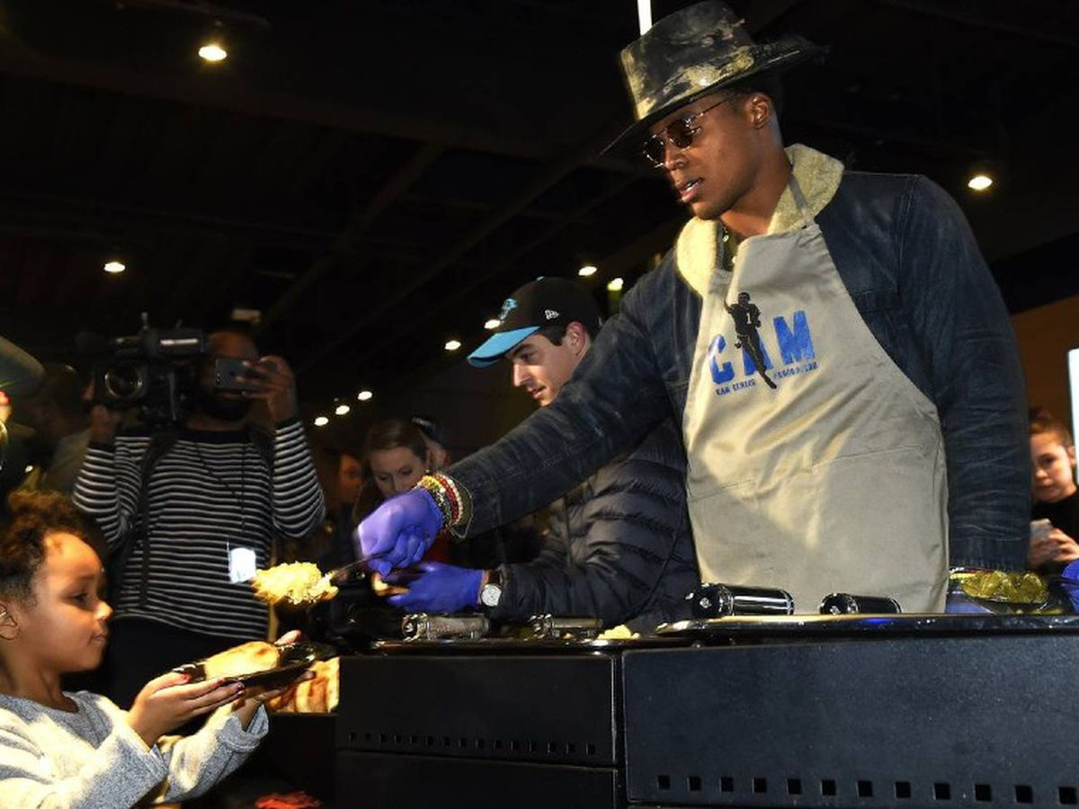 Cam Newton's effect on Charlotte? He fed the homeless after Panthers home games