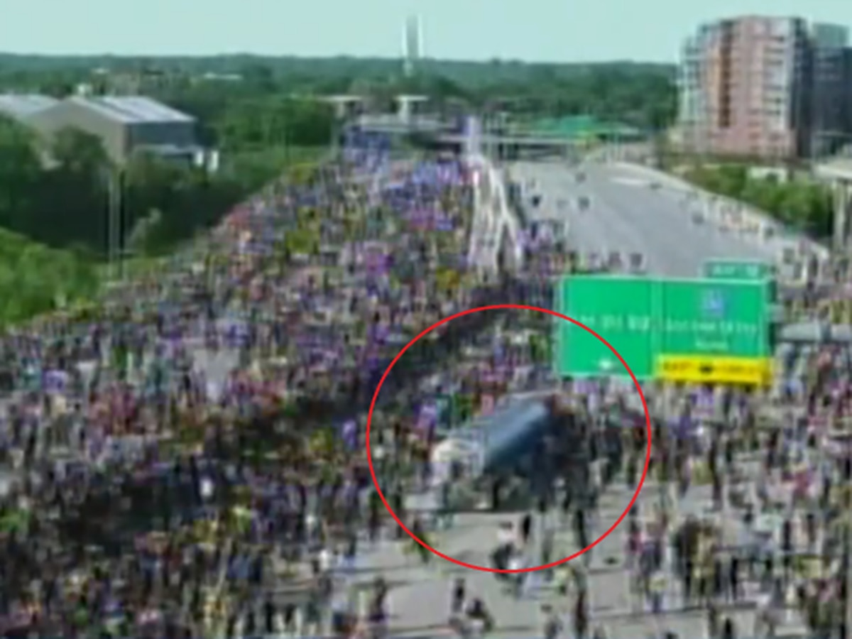 Truck driver arrested after appearing to drive through protesters on Minneapolis interstate