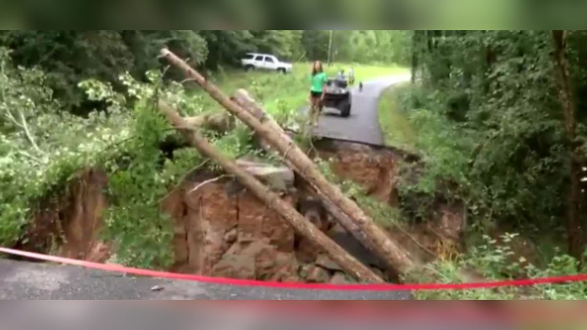 Heavy rain washes out N.C. road to seven families