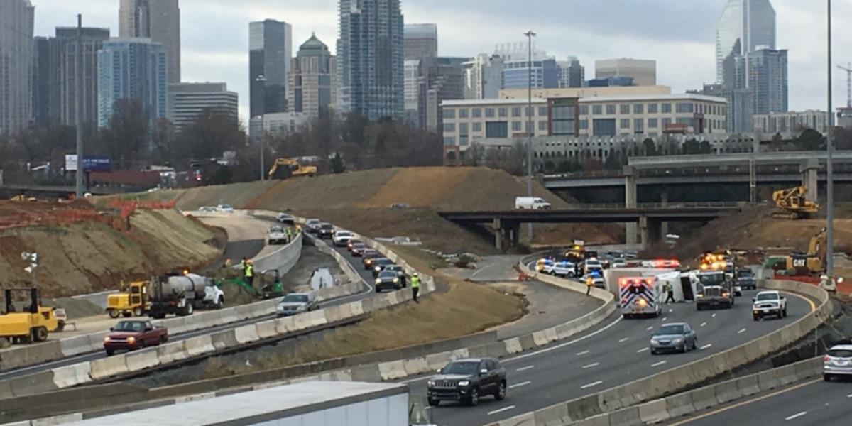 Tractor-trailer overturns on I-77, blocks several lanes