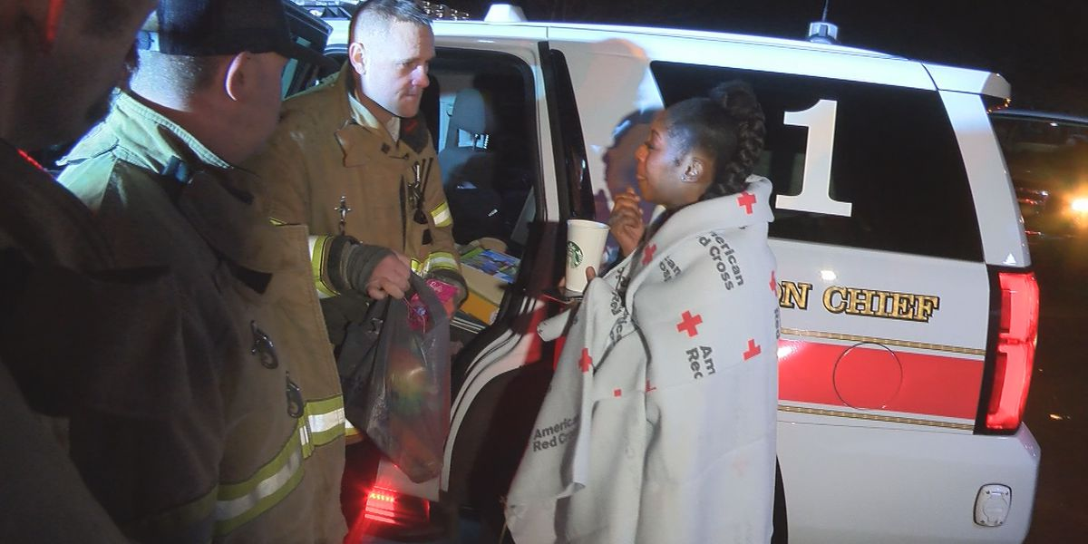 Charlotte firefighters surprise family with Christmas gifts after house fire displaces them from home