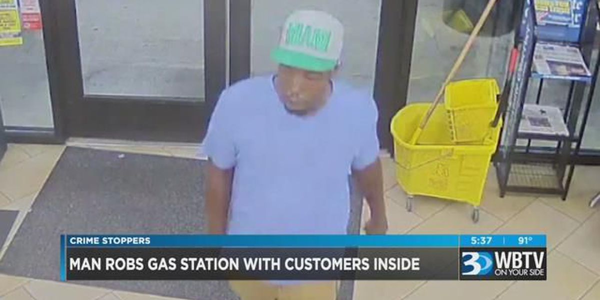 Man robs gas station with customers inside