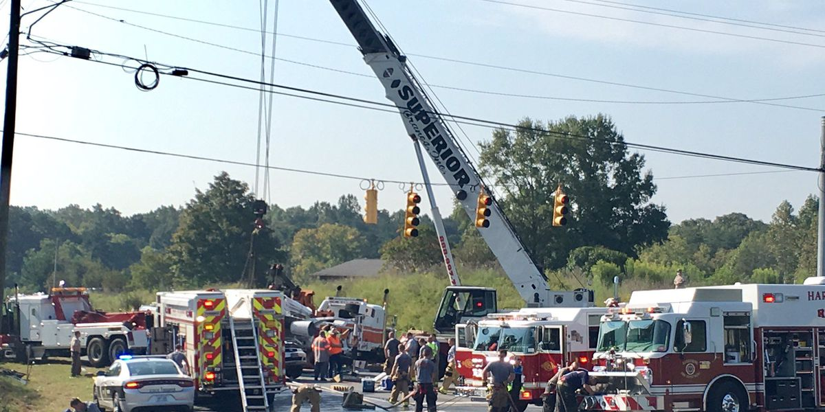 Two airlifted, two others injured after truck carrying 20 tons of concrete rolls onto van