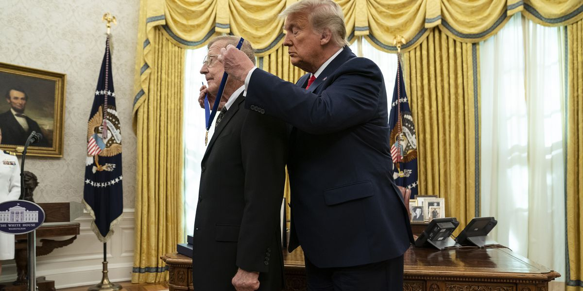 Trump honors football coach Holtz as 'one of the greatest'