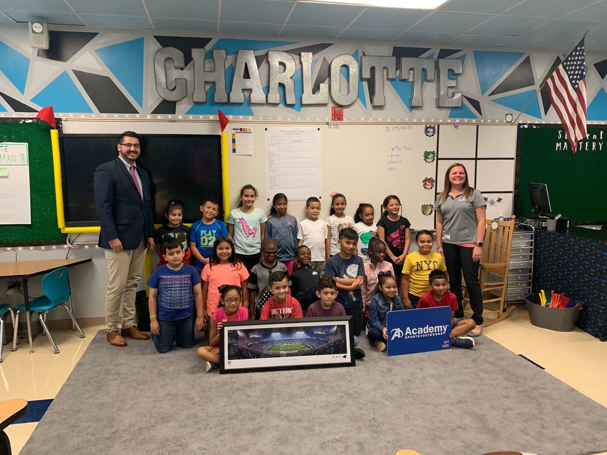 Pineville teacher with Panthers-themed classroom surprised with sideline tickets