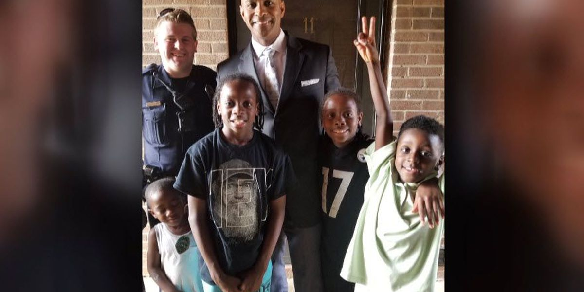Two boys survive shooting, 'adopt' police officer who responded