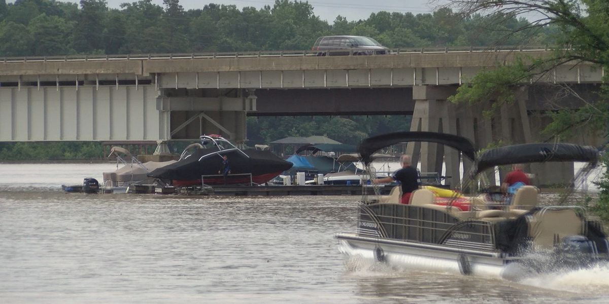 Flood waters force boats away from docks on Mountain Island Lake