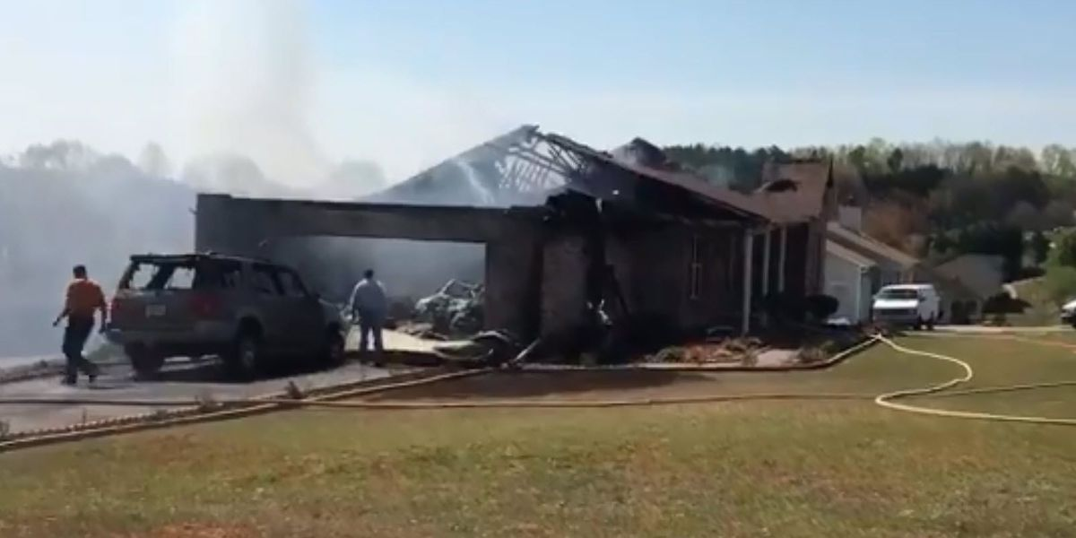 Fire destroys home, husband and wife jump to safety