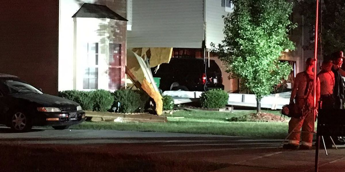 One injured when SUV crashes into two homes in northeast Charlotte
