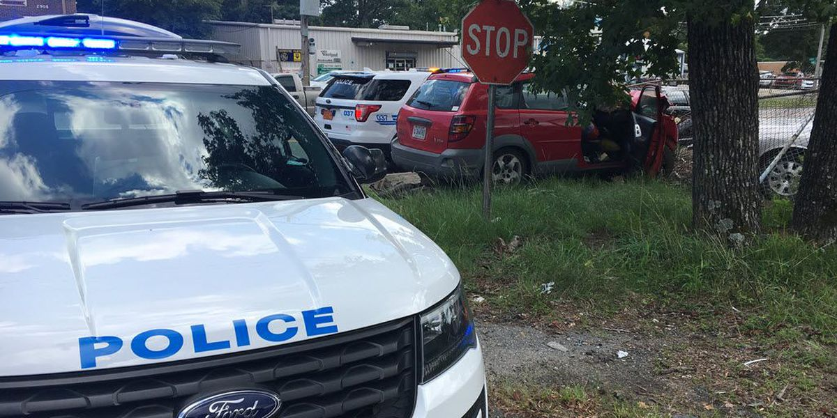 Driver sideswipes CMPD vehicle, hits utility pole in north Charlotte