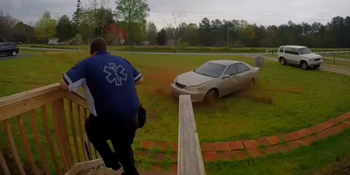 VIDEO: Paramedic nearly struck by alleged impaired driver while walking out of house