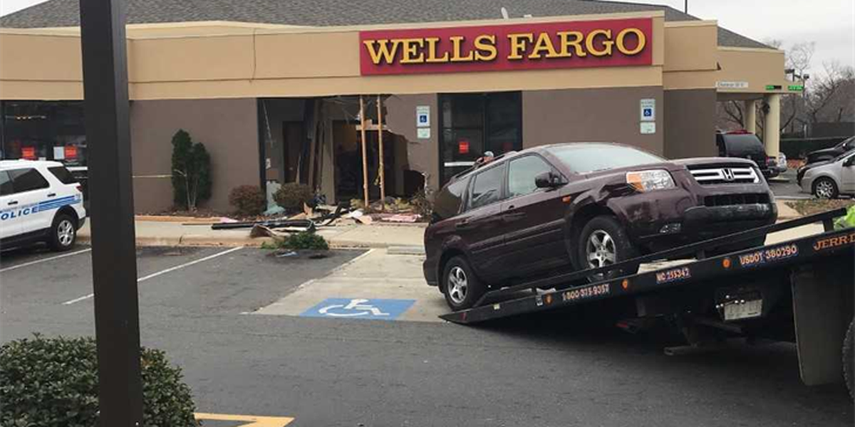 Large hole left after car crashes into Wells Fargo Bank