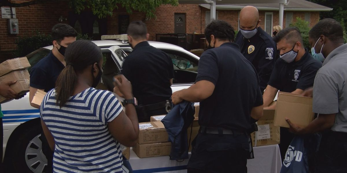Charlotte Mecklenburg Police officers hand out 800 free gun locks in an attempt to save lives