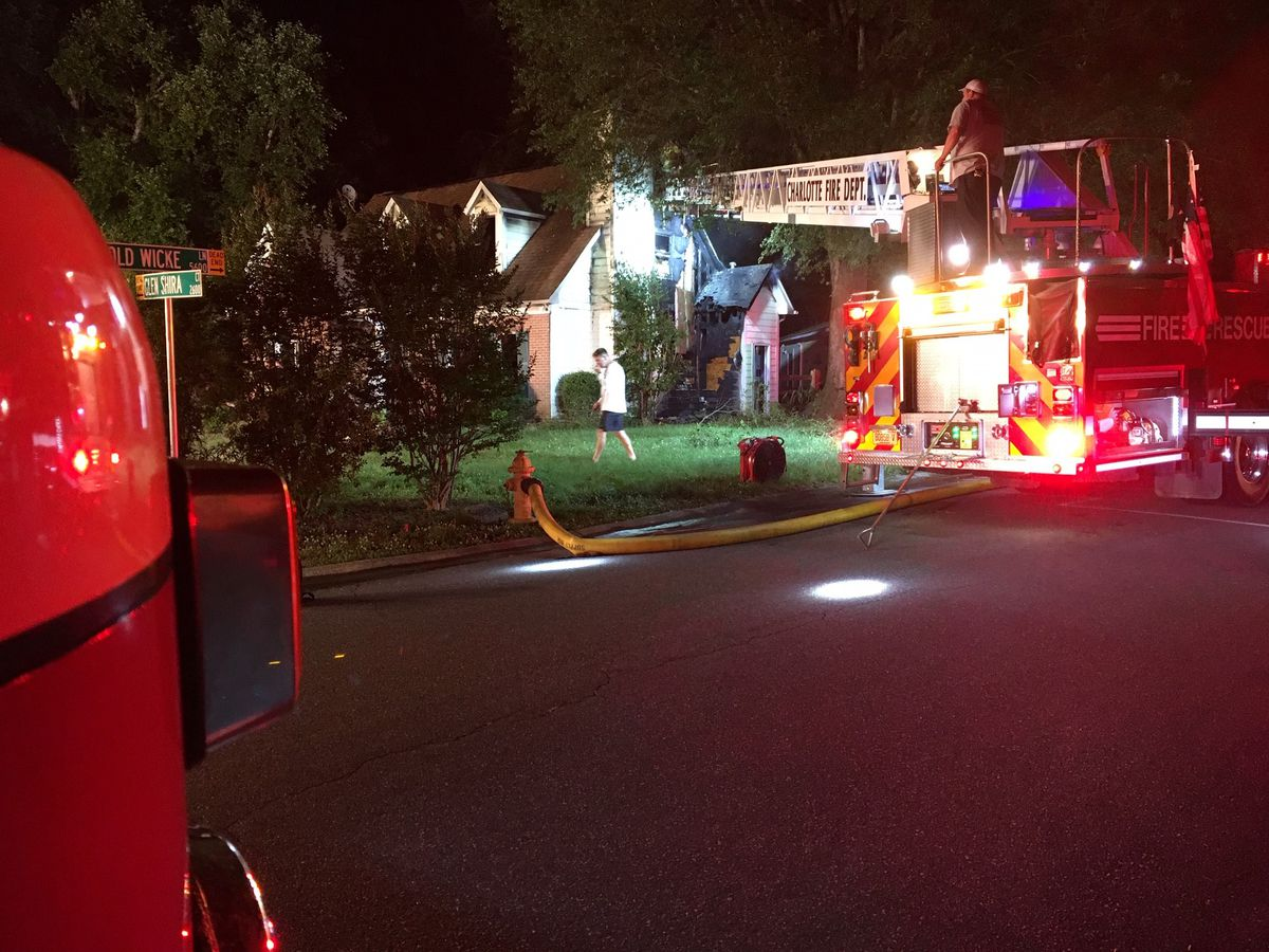 Officials respond to house fire in Charlotte