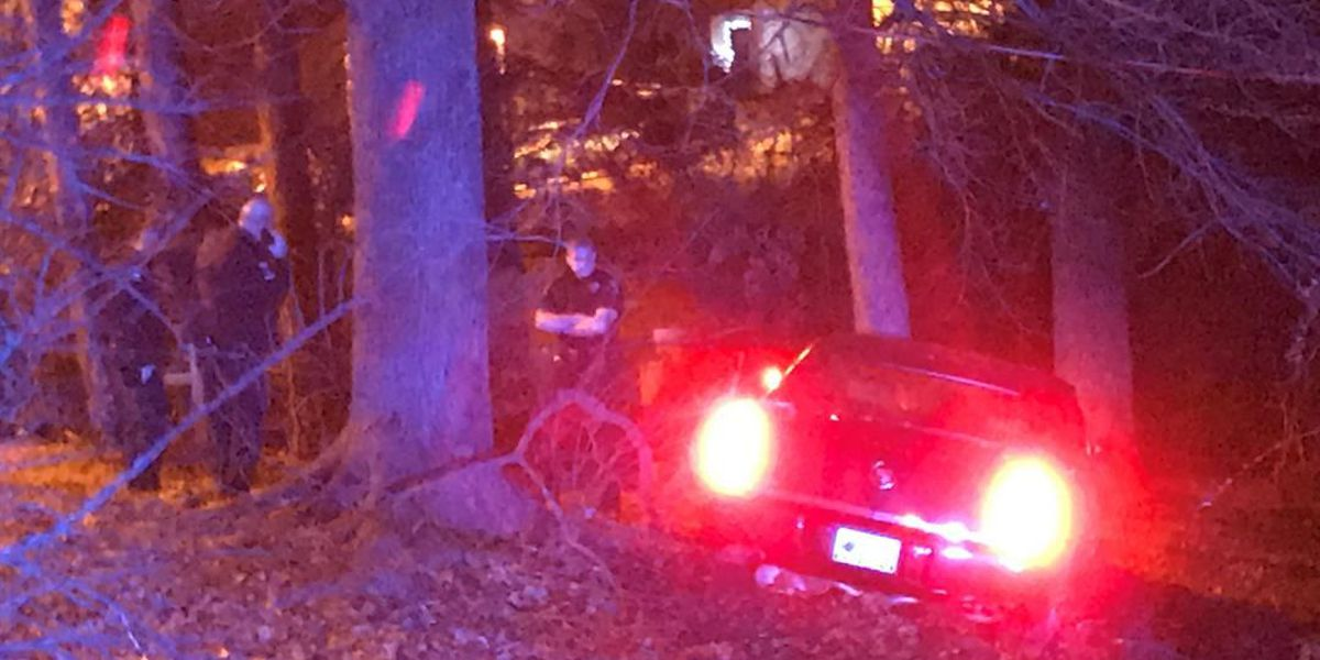 Abandoned car found with damage behind home in east Charlotte