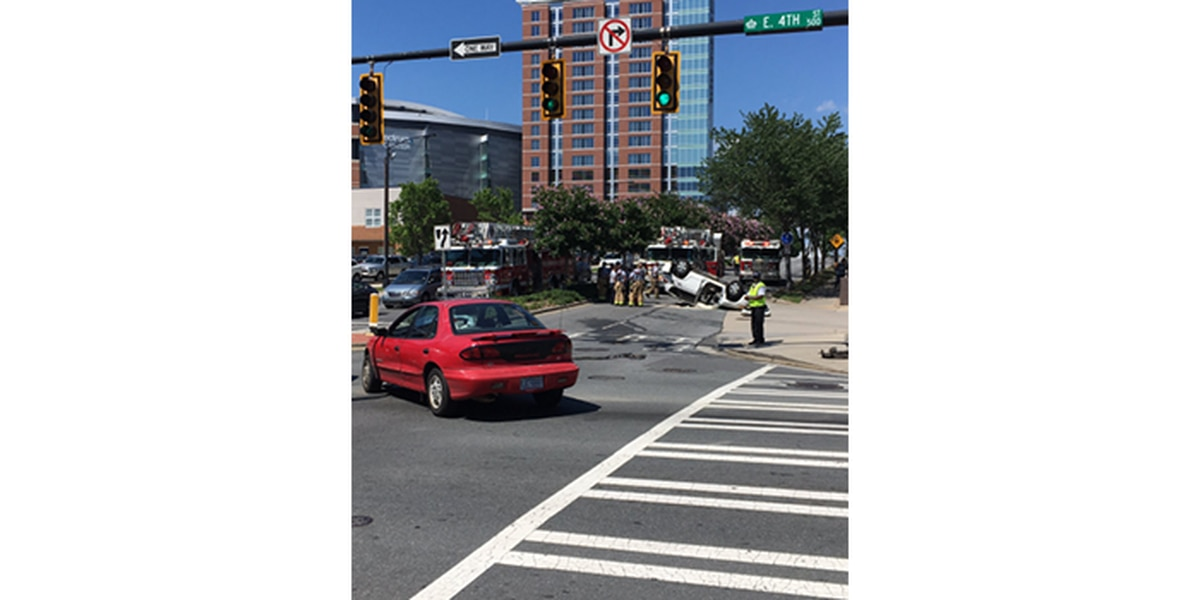 One rescued when vehicle overturns in uptown Charlotte