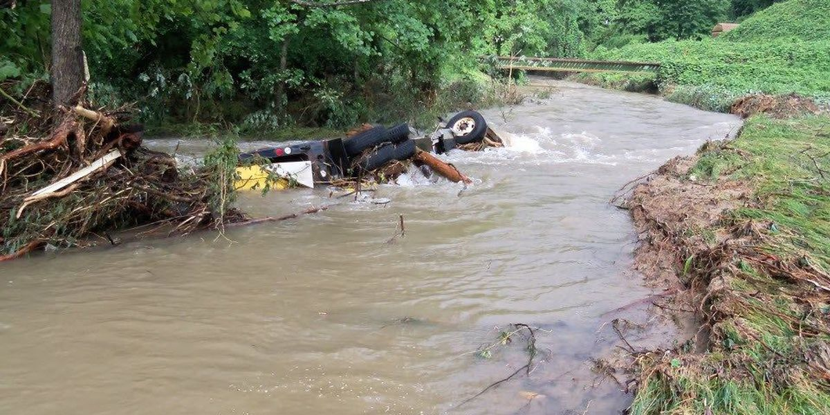 NCDOT workers rescued after mudslide sweeps dump truck into river