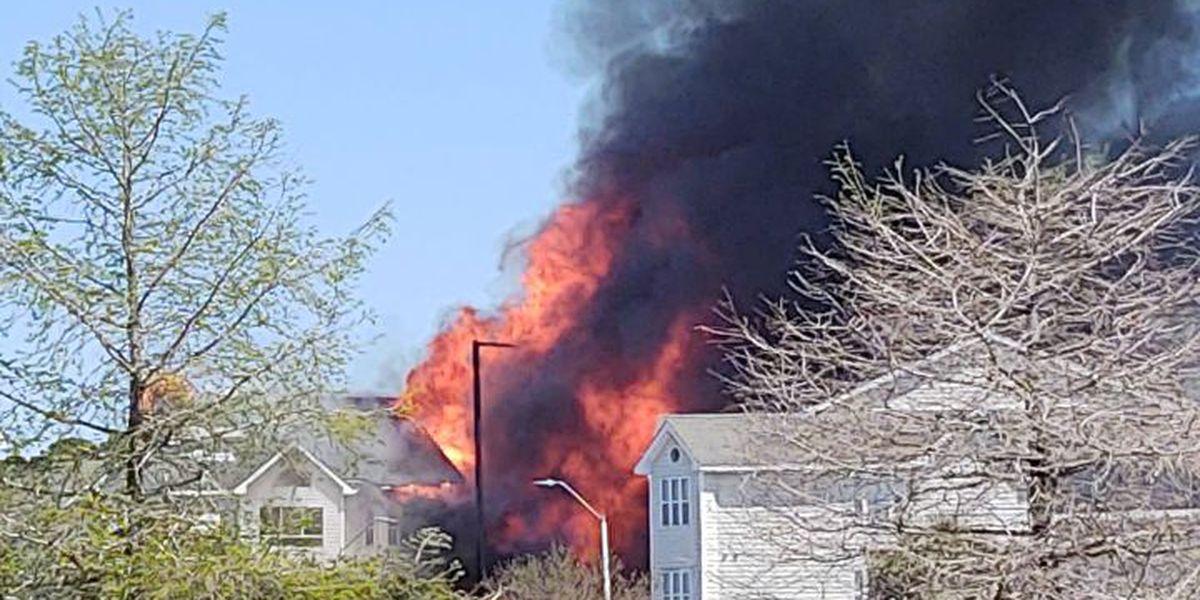 Four hurt after massive fire rips through Carolina Beach condominium complex