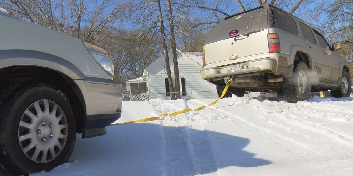 Volunteer group offers help to drivers stuck in the snow after winter storm