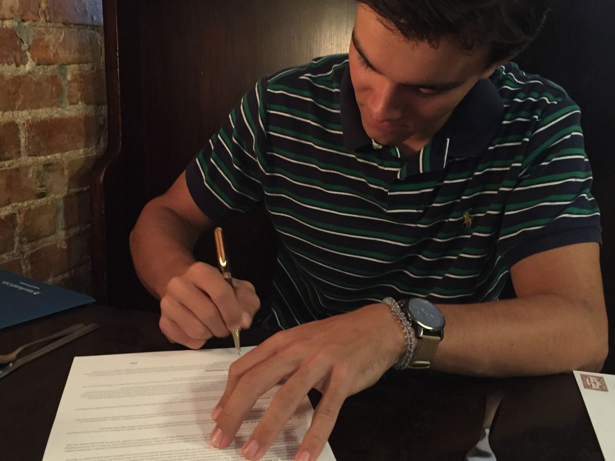 Myers Park senior with full-ride scholarship creates pens to give back to local charity