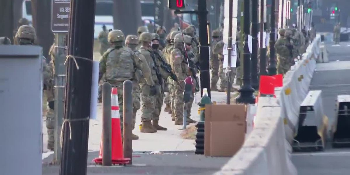 Troops screened for threats in fortified DC