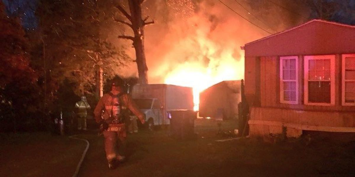 Firefighters respond to heavy fire coming from Huntersville house
