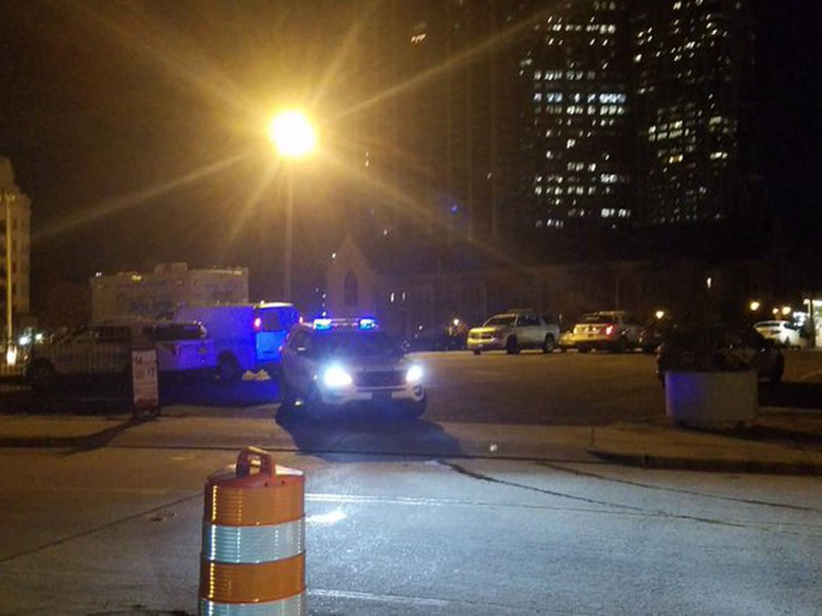 Shots fired in Uptown parking lot kill carjacking suspect, hit car of woman, nearby apartment