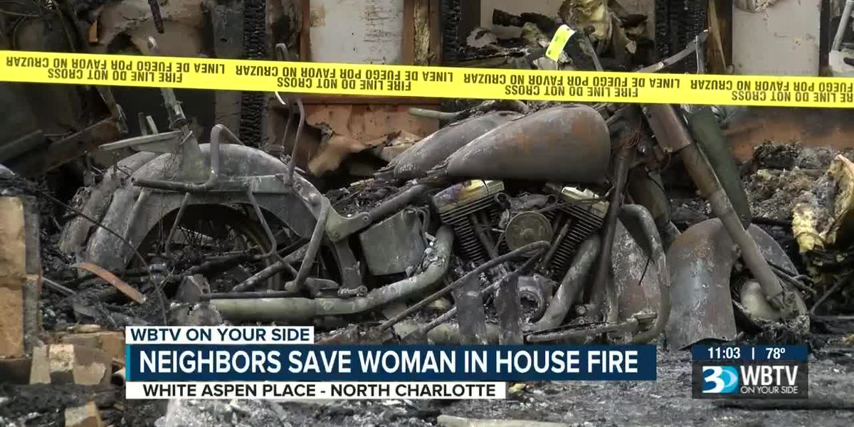 Video shows neighbors pulling woman from Charlotte house fire