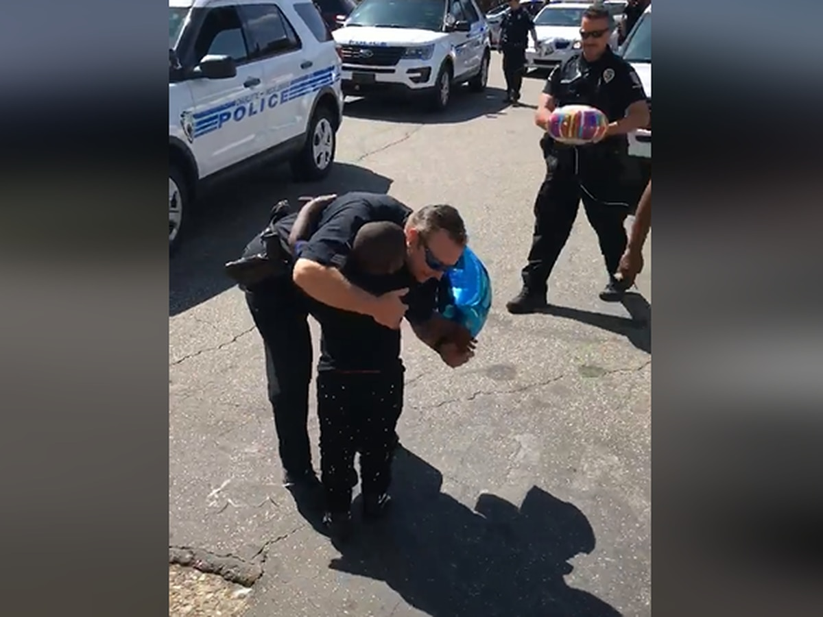 Charlotte police officers surprise boy for fourth birthday
